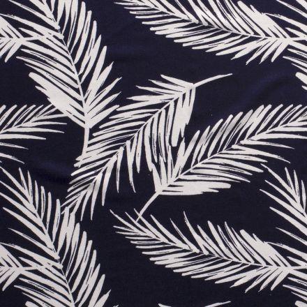 Tissu Jersey Viscose avec aspect crêpe Feuilles de palmiers blanches sur fond Bleu marine - Par 10 cm