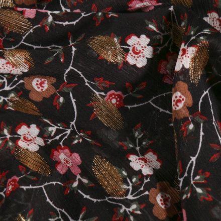 Tissu Mousseline de crépon  Fleurs rouge et blanches pois lurex bronze sur fond Noir - Par 10 cm