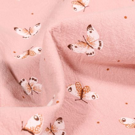 Tissu Coton lavé Papillons colorés sur fond Rose poudré