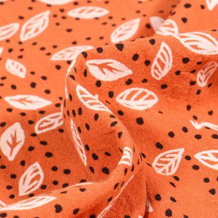 Tissu Coton lavé Feuilles et pois sur fond Orange