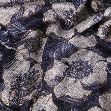 Tissu Maille Fleurs blanches et lurex sur fond Bleu jean - Par 10 cm