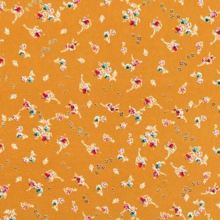 Tissu Microfibre léger Pailleté Branches fleuries multicolores sur fond Moutarde - Par 10 cm