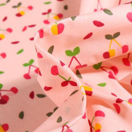 Tissu Coton enduit Cerises multicolores sur fond Rose