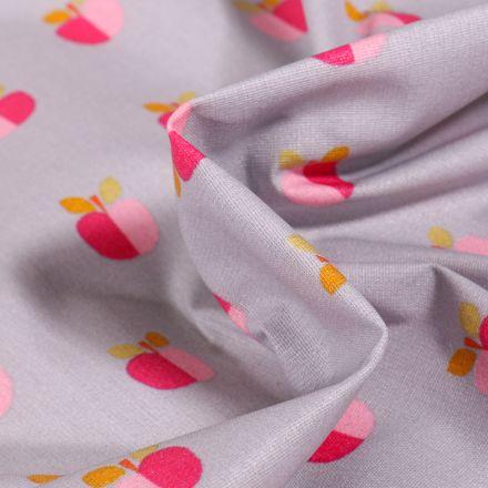 Tissu Coton enduit Pommes bicolores sur fond Gris clair