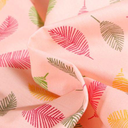 Tissu Coton enduit Feuilles multicolores sur fond Rose