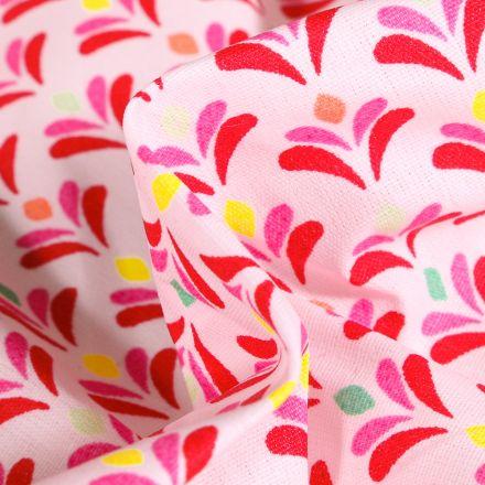 Tissu Coton enduit Pétales multicolores sur fond Rose