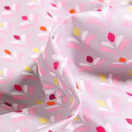 Tissu Coton enduit Pétales multicolores sur fond Gris clair