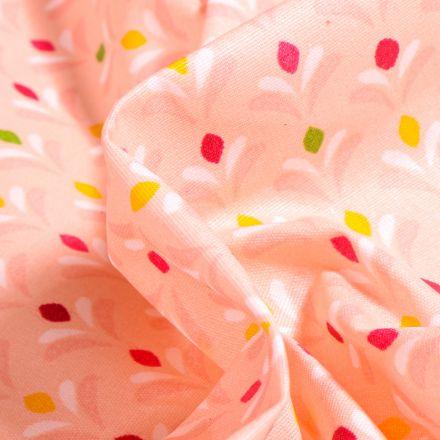 Tissu Coton enduit Pétales multicolores sur fond Saumon