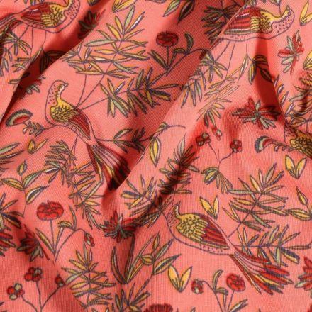 Tissu Jersey Coton Oiseaux et feuillages sur fond Corail - Par 10 cm