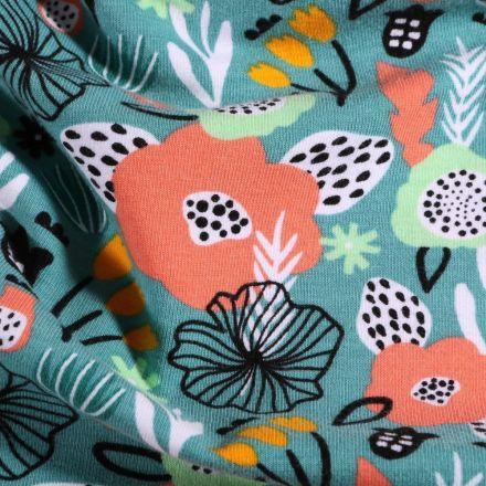 Tissu Jersey Coton Fleurs stylisées sur fond Bleu - Par 10 cm