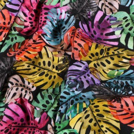 Tissu Jersey Coton Feuilles de Monstera multicolore sur fond Noir - Par 10 cm