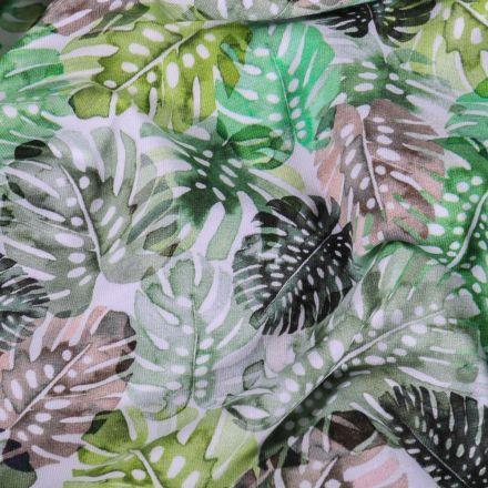 Tissu Jersey Coton Feuilles de Monstera vertes et grises sur fond Blanc - Par 10 cm