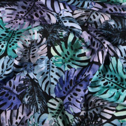 Tissu Jersey Coton Feuilles de Monstera vertes et bleues sur fond Noir - Par 10 cm