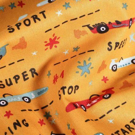Tissu Coton imprimé LittleBird Courses de voitutres sur fond Jaune curcuma - Par 10 cm