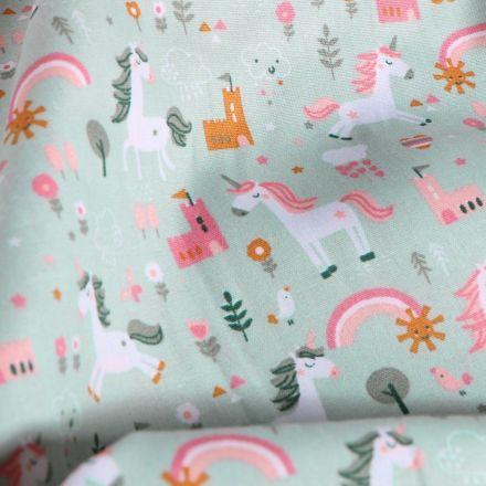 Tissu Coton imprimé LittleBird Licornes et chateaux sur fond Vert menthe clair - Par 10 cm