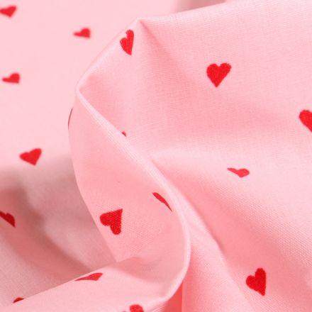 Tissu Coton enduit Petits cœurs rouges sur fond Rose