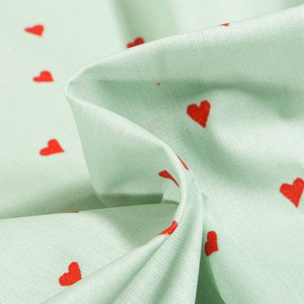 Tissu Coton enduit Petits cœurs rouges sur fond Vert menthe