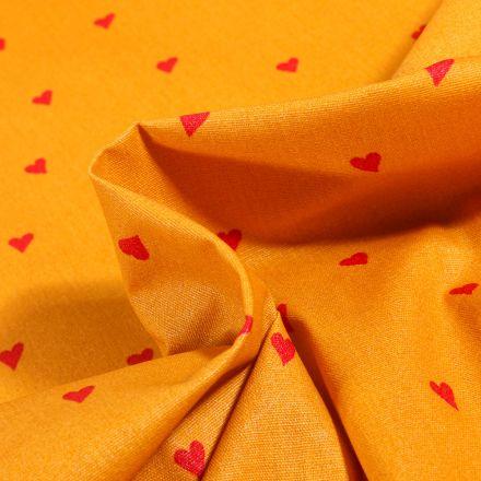 Tissu Coton enduit Petits cœurs rouges sur fond Jaune curcuma