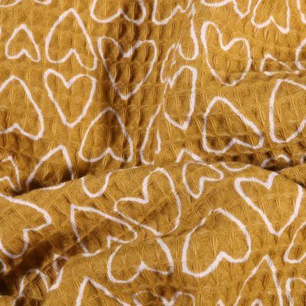 Tissu Nid d'abeille imprimé Cœurs Blancs sur fond Moutarde - Par 10 cm