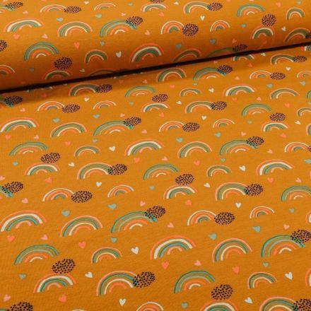 Tissu Jersey Coton Bio Arc en ciel sur fond Ocre - Par 10 cm