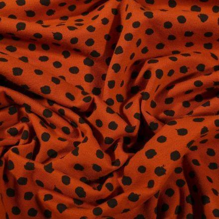 Tissu Jersey Coton Bio Pois déstructurés noirs sur fond Rouille - Par 10 cm