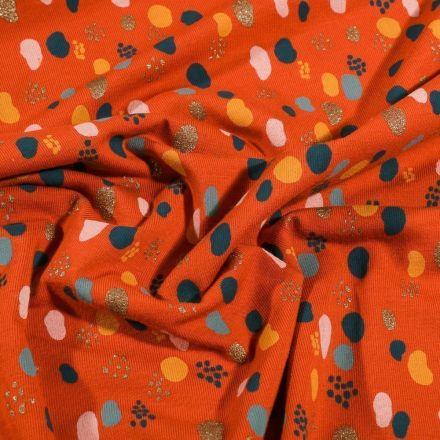 Tissu Jersey Coton Petits points et pois déstructuré pailleté sur fond Orange - Par 10 cm