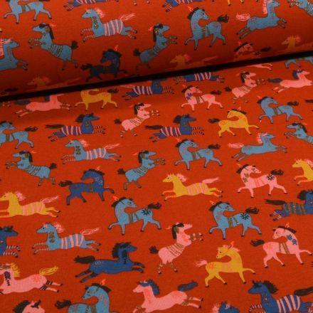 Tissu Jersey Coton Chevaux indiens sur fond Brique - Par 10 cm