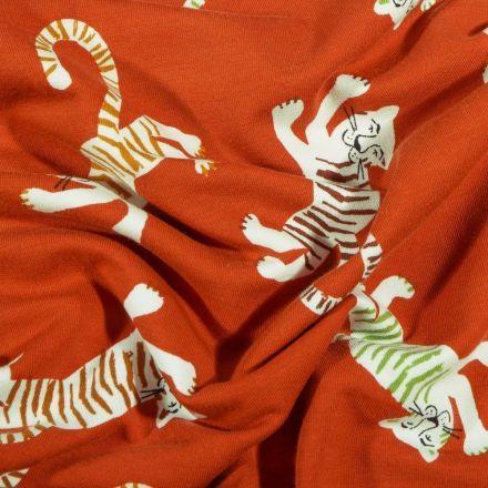 Tissu Jersey Coton Tigres colorés sur fond Rouille - Par 10 cm