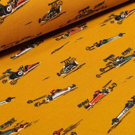 Tissu Jersey envers molletonné  Voitures Formule 1 sur fond Jaune - Par 10 cm