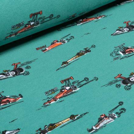 Tissu Jersey envers molletonné  Voitures Formule 1 sur fond Bleu pétrole - Par 10 cm