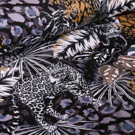 Tissu Jersey Viscose Fleurs et léopards gris et ocre sur fond Noir - Par 10 cm