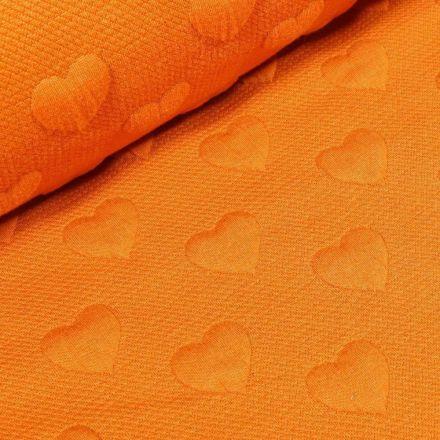 Tissu Sweat Cœurs en relief sur fond Orange - Par 10 cm