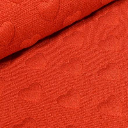 Tissu Sweat Cœurs en relief sur fond Rouge - Par 10 cm