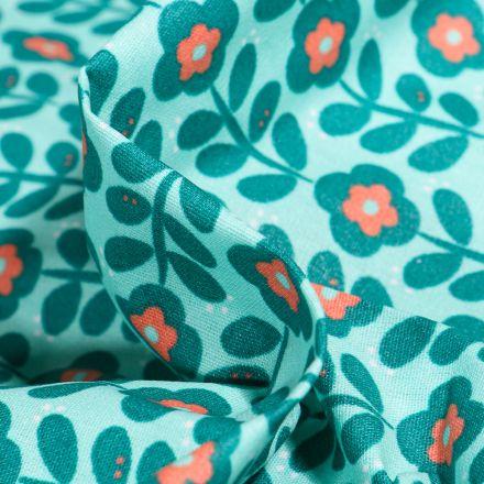 Tissu Coton enduit Fleurs seventies sur fond Bleu lagon