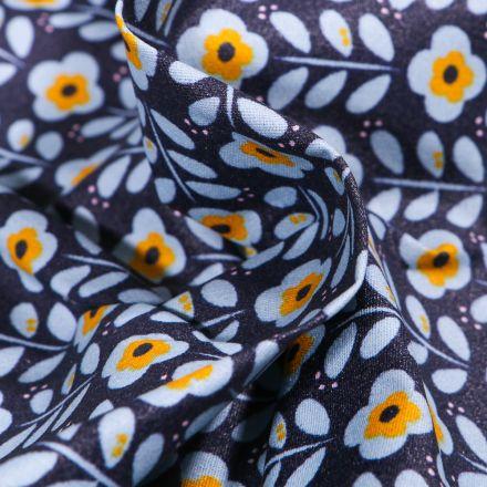 Tissu Coton enduit Fleurs seventies ciel et jaune sur fond Bleu nuit