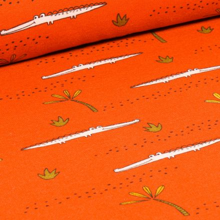 Tissu Jersey Coton Bio Crocodile et palmier sur fond Orange