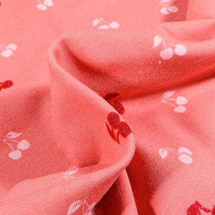 Tissu Jersey Coton Cerises sur fond Corail