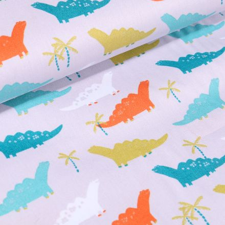 Tissu Coton imprimé LittleBird Dinosaures orange, bleus et verts sur fond Blanc