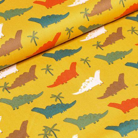 Tissu Coton imprimé LittleBird Dinosaures colorés sur fond Jaune