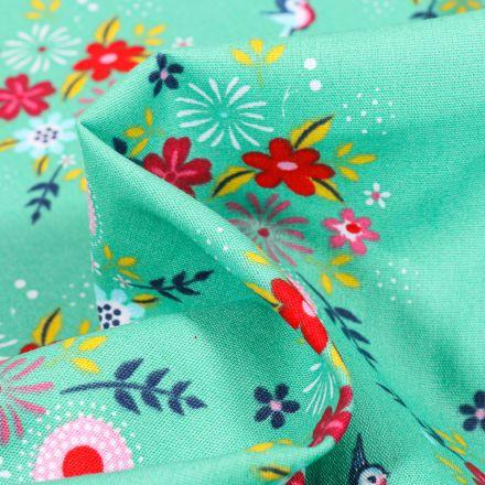 Tissu Coton imprimé Fleurs estivales sur fond Vert menthe