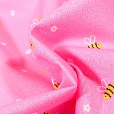 Tissu Coton imprimé Abeille et petites fleurs sur fond Rose bonbon