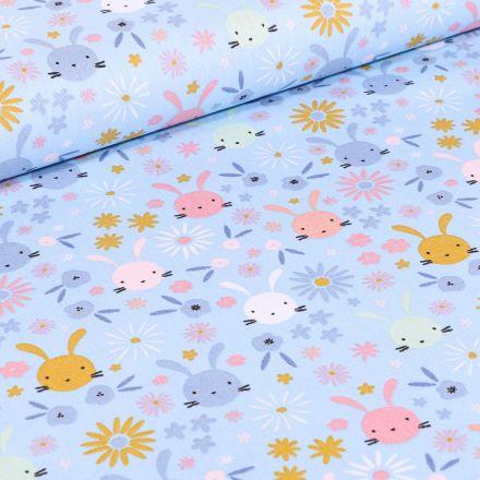 Tissu Coton imprimé Têtes lapinou sur fond Bleu ciel