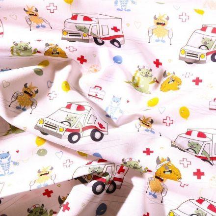 Tissu Coton Bio imprimé Monstres et ambulances sur fond Blanc - Par 10 cm