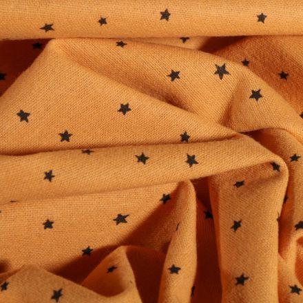 Tissu Flanelle de coton Petites étoiles noires sur fond Jaune moutarde - Par 10 cm