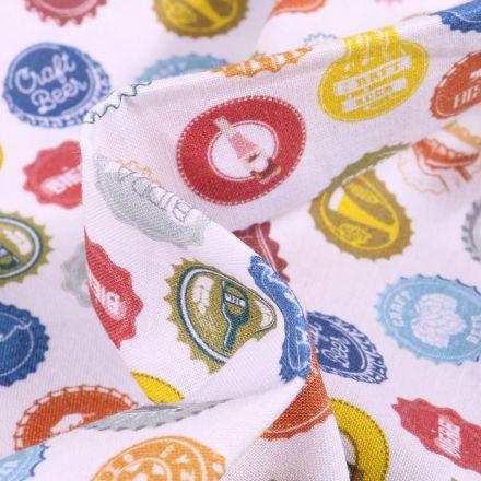 Tissu Coton imprimé Bio Capsules de Bières sur fond Blanc