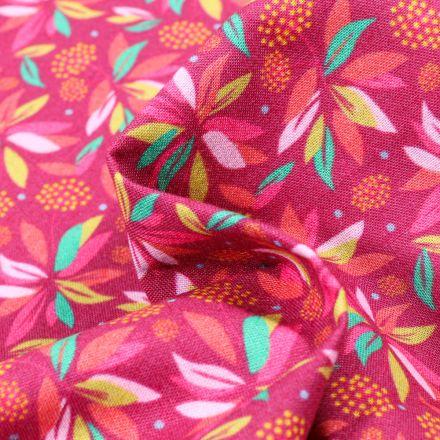 Tissu Coton MC Fabrics Feuilles colorés sur fond Framboise