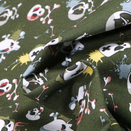 Tissu Coton MC Fabrics Têtes de morts énervés sur fond Vert kaki foncé