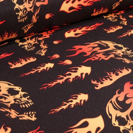 Tissu Burlington Têtes de mort flammes sur fond Noir