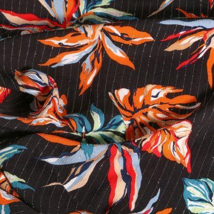 Tissu Crépon Viscose Feuilles de monstera colorées rayures lurex sur fond Noir - Par 10 cm