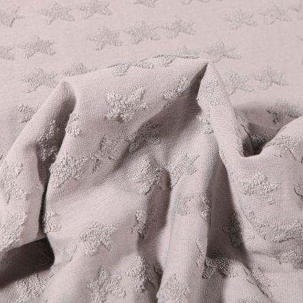Tissu Jersey Coton Etoiles en relief sur fond Gris clair - Par 10 cm